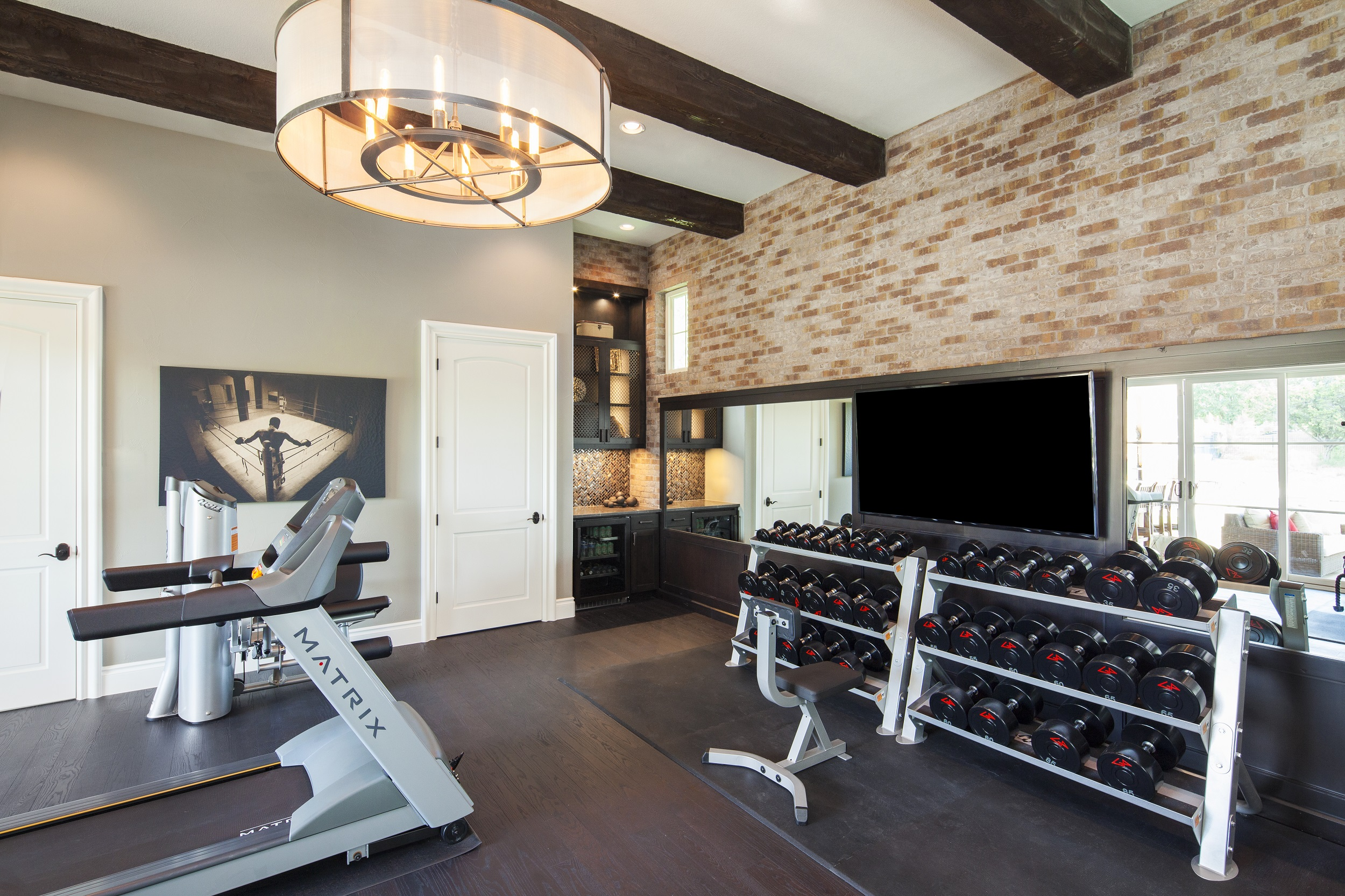 the space combines historic references with a clean aesthetic to form a masculine gym maintaining its integrity through the use of high end finishes and
